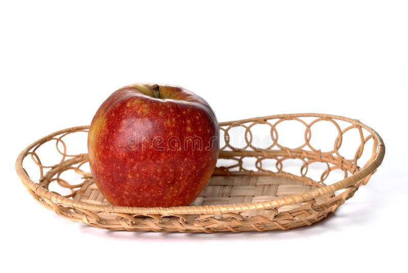 Download Red Apple On Wattled Plate Isolated Stock Image - Image: 17933367