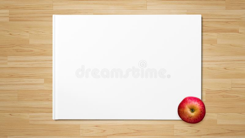 Red Apple on white paper. Red tasty Apple on the corner of white paper on wooden table background stock photos