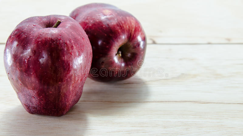Red apple on wooden background stock photography