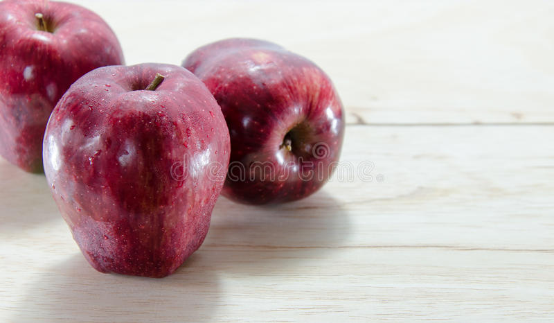 Red apple on wooden background royalty free stock image