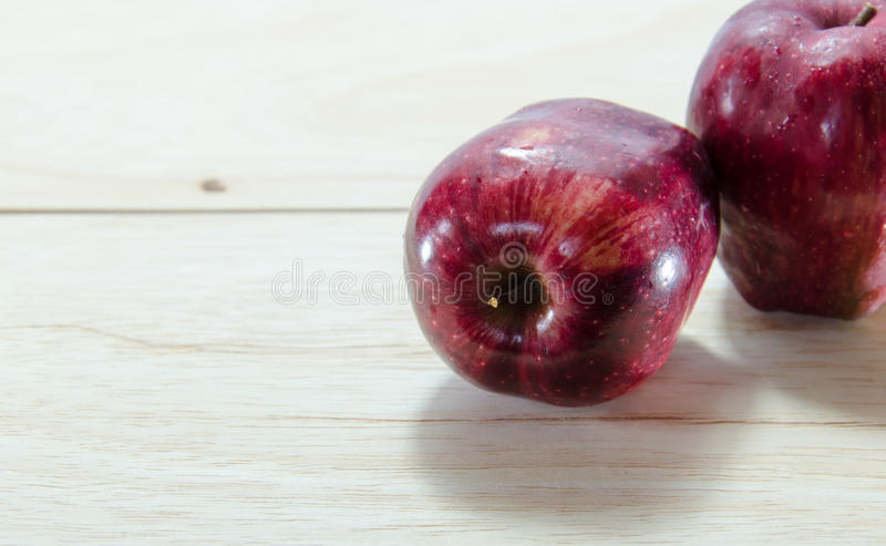 Red apple on wooden background stock photo