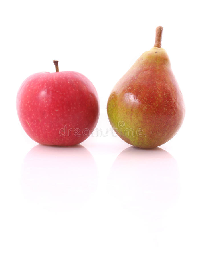 Red Apple And Yellow-green Pear Isolated Stock Photography