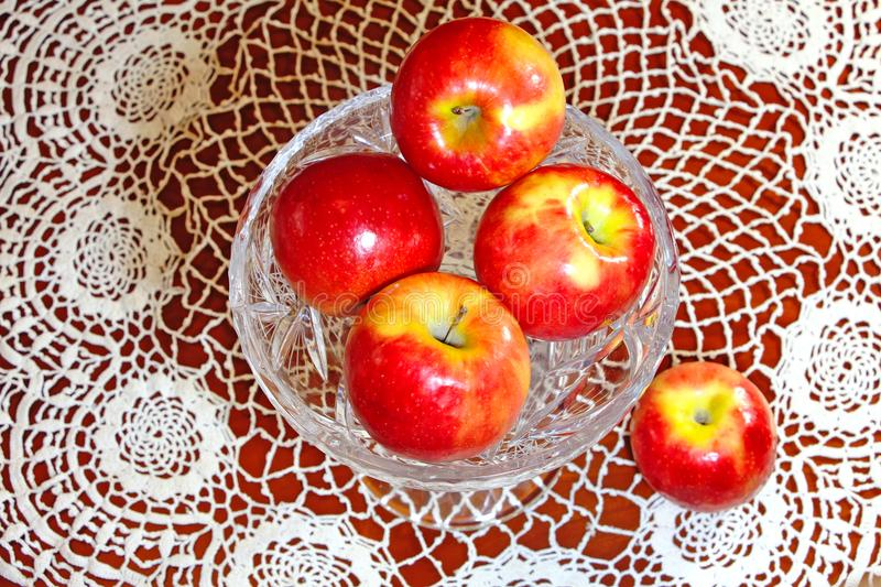 Red apples on aglass tray stock photography