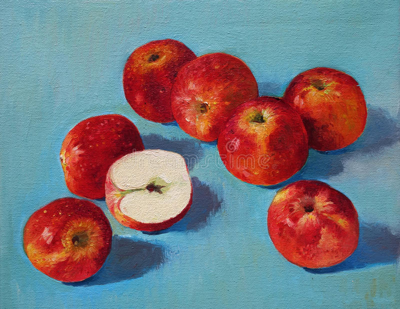 Red apples on blue background royalty free stock photography