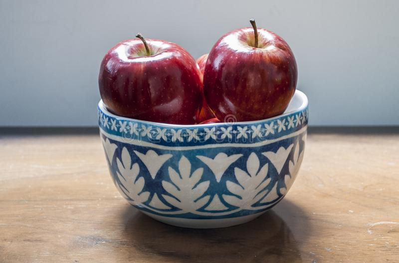 Red apples in a bowl royalty free stock photo