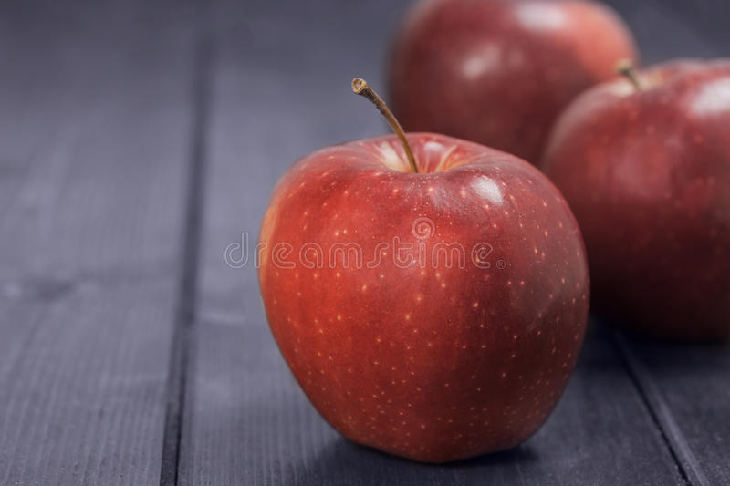 Red apples on a dark blue background stock photo