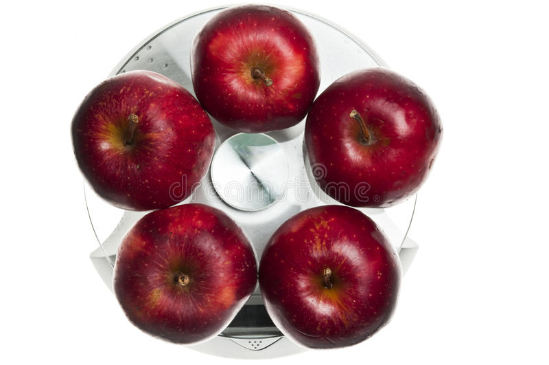 Red apples on food scale. Red apples isolated on food scale stock image