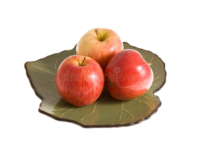Red apples on the plate stock photos