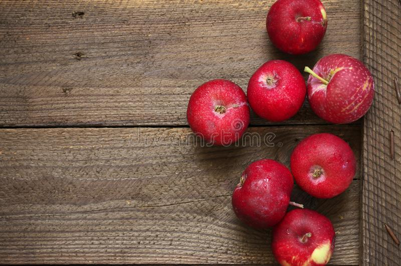 Red apples on rustic wood. Organic red apples on brown rustic weathered wood. Top view royalty free stock images
