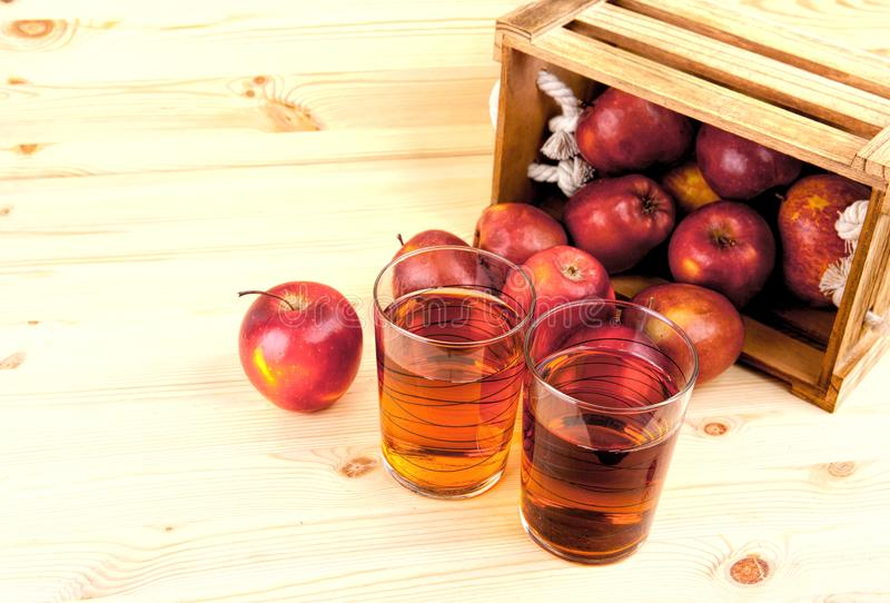 Red apples on table in wooden crate, pile of fresh apple . royalty free stock images