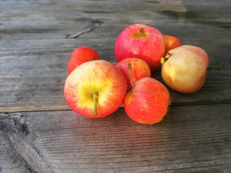 Download Red Apples On A Wooden Surface Stock Photo - Image: 34257492