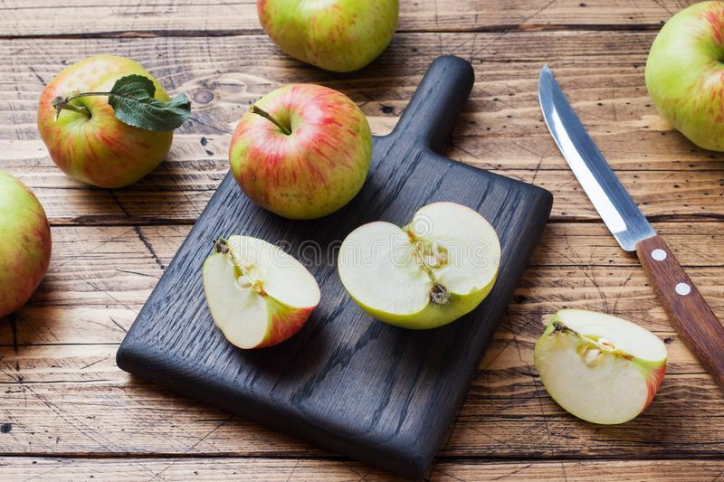 Red apples on a wooden table. Apples cut into slices. Copy space royalty free stock photos