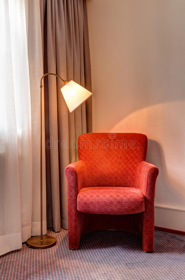 red armchair and lamp in the room corner royalty free stock photography image 36834197. Black Bedroom Furniture Sets. Home Design Ideas
