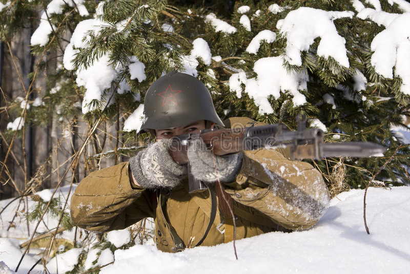 Red Army soldier aims from a rifle royalty free stock image