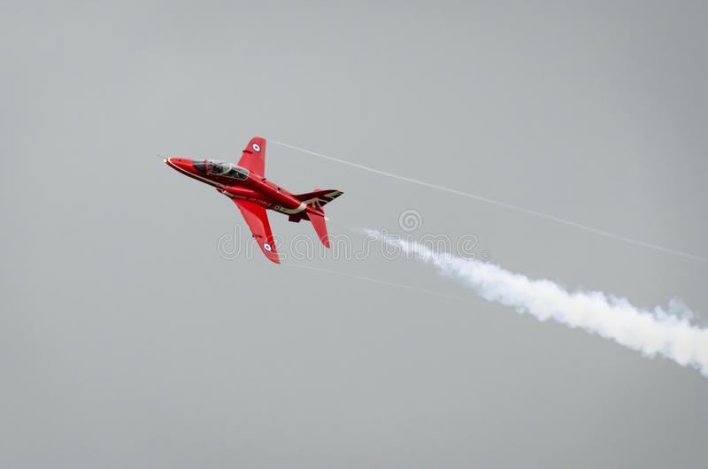 Red Arrow Aeroplane in Flight royalty free stock image