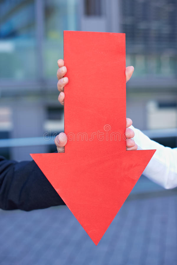 Red arrow pointing down royalty free stock photo