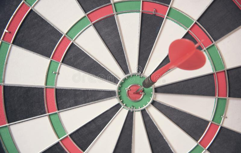 Red arrow target center of dartboard. concept business goal. To marketing success royalty free stock photos