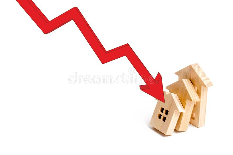 The red arrow triggers one another at home, a chain reaction of the fall. Colaps dominoes. Reclamation of the real estate market. Falling prices and real stock photography