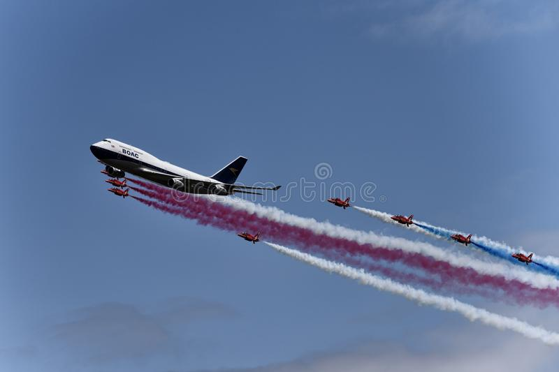 Red Arrows with a BA 747 stock images