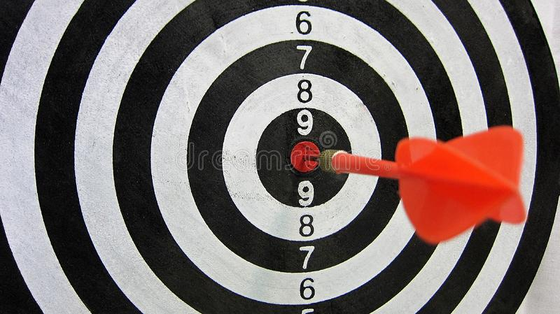 Red arrows in the center Bullseye target. Goal. Target. Can be used for site design, banner, profile in social networks, etc. - the concept of success and the royalty free stock image