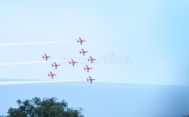High and mighty!!!. Red Arrows displaying an amazing Air show at Eastbourne, England stock images