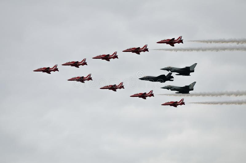 Red Arrows, Eurofighter Typhoon and F35 Lightning in formation stock images