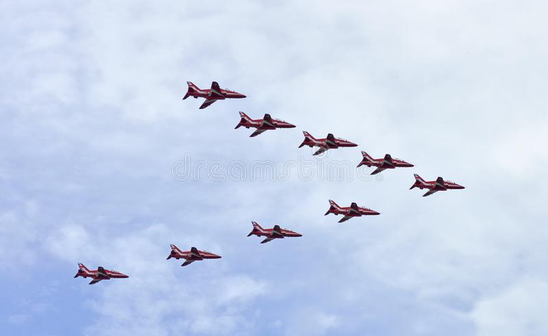 Red arrows flying high over Ottawa Canada. Ottawa, Ontario, Canada, August 13, 2018: The Red Arrows elite flying team from The Royal Air Force in Great Britain royalty free stock images