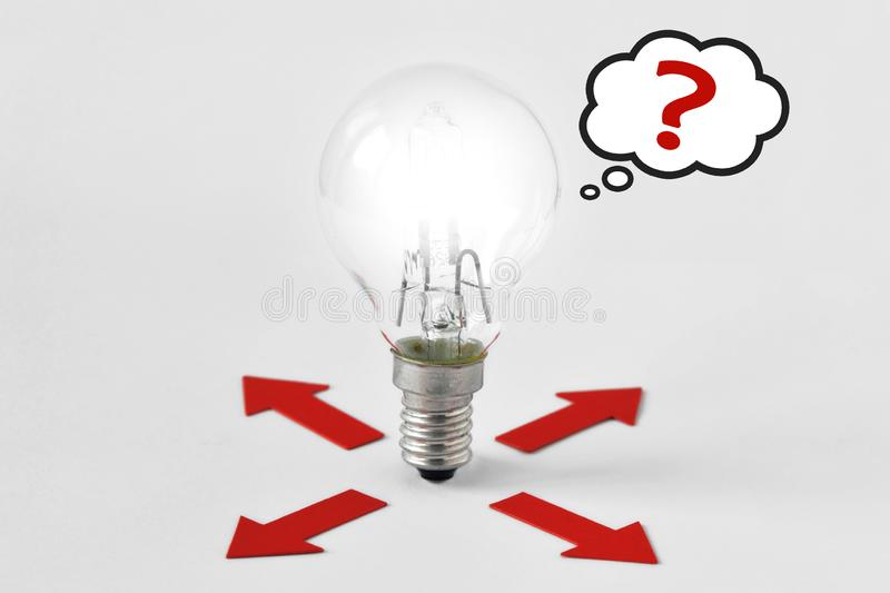 Red arrows and light bulb thinking about which way choosing - Choice way concept. Red arrows and light bulb thinking about which way choosing. Choice way concept stock photography