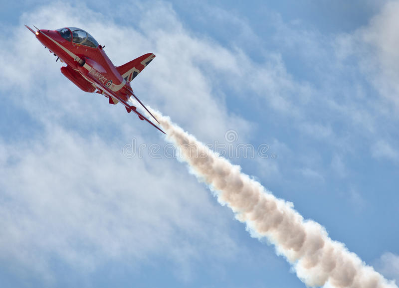 Red Arrows. The Royal Air Force Aerobatic Team, the Red Arrows, is one of the world's premier aerobatic display teams. Representing the speed, agility and royalty free stock photo