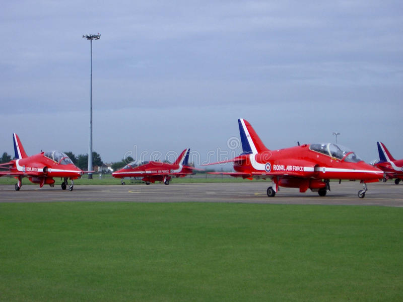 Red Arrows. The Red Arrows on the tarmac at Scampton Airfield stock image
