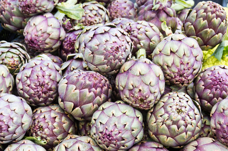 Red artichokes on display royalty free stock images