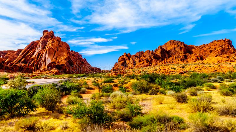Red Aztec Sandstone Mountains at the Mouse`s Tank Trail in the Valley of Fire State Park in Nevada, USA stock image