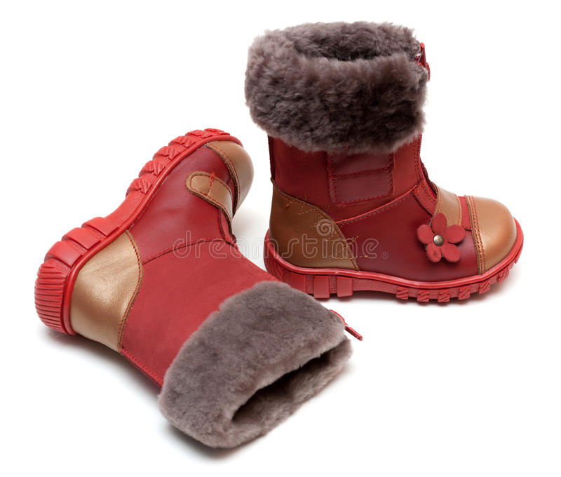 Red baby boots with fur. On white background stock photos