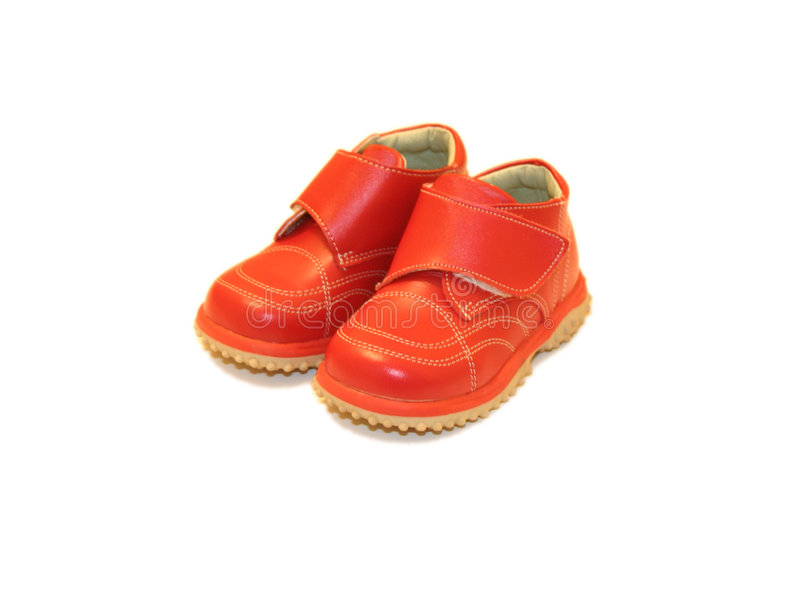 Red baby shoes. A pair of shiny red baby shoes royalty free stock photos