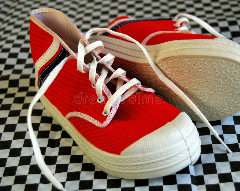 Red Baby Shoes. Red high top baby tennis shoes with stripes stock photography
