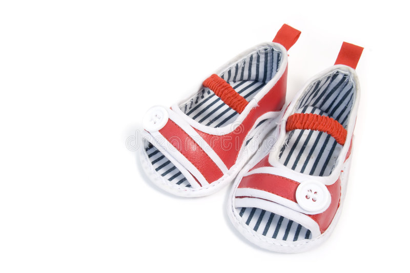 Red baby shoes. A pair of red baby shoes royalty free stock photo