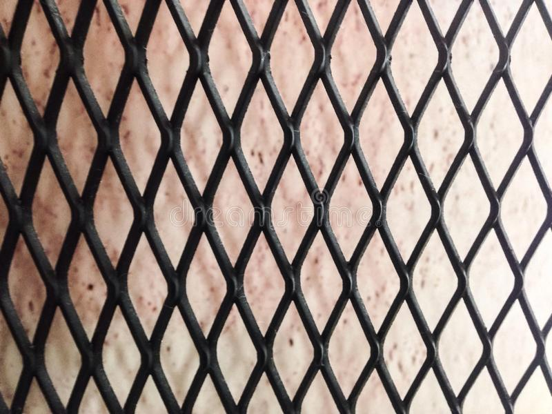 Red background with black steel net wall royalty free stock images