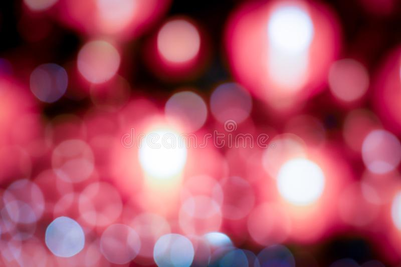 Red background blurred light christmas holiday pattern. Abstract decoration bokeh gllitter. Xmas and chinese new year or valentine festive royalty free stock images
