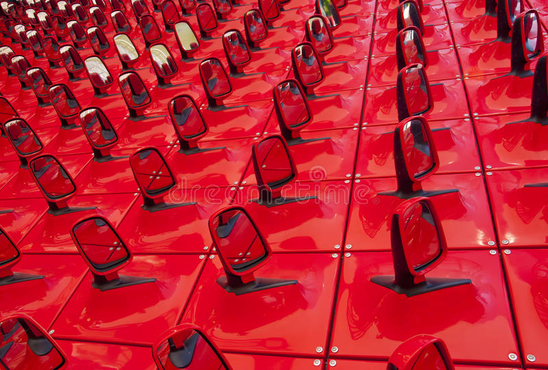 Red background in the form of automobile mirrors royalty free stock image