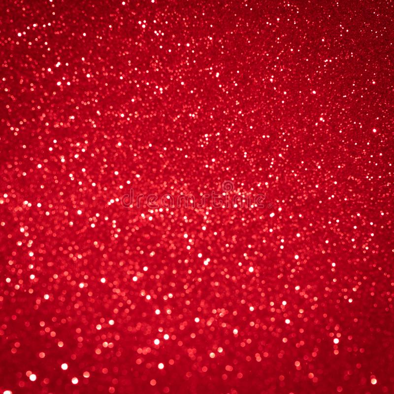 Red background light christmas holiday pattern. Abstract decoration bokeh gllitter xmas and new year or valentine festive. stock photography