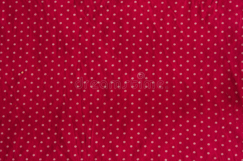 Red background with polka dots. Red cloth with white polka dots royalty free stock image