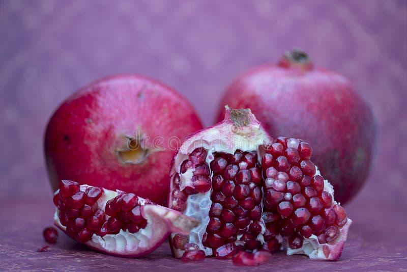Yummy juicy pomegranates royalty free stock images