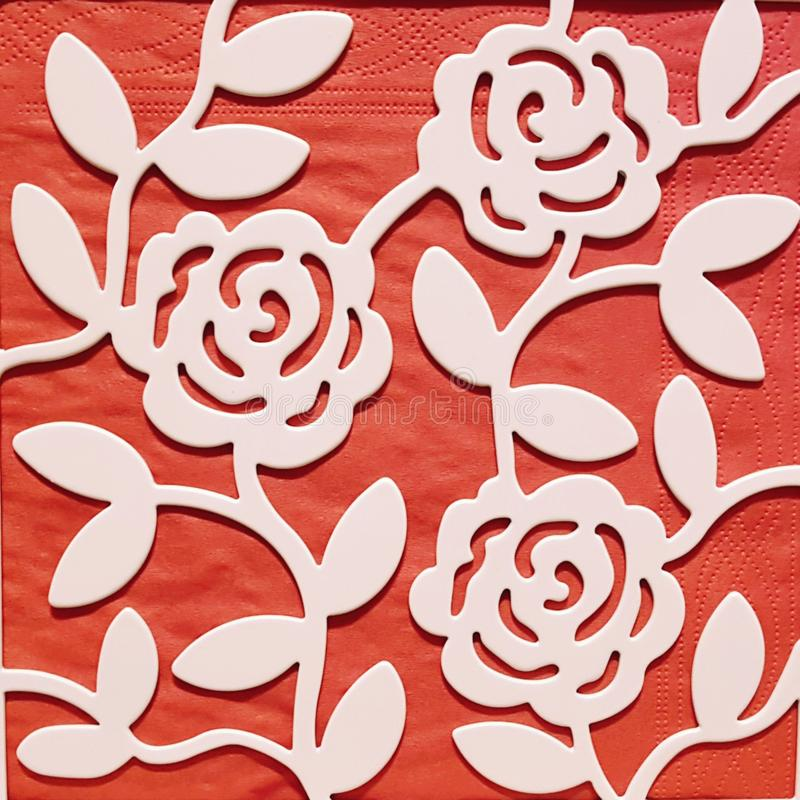 Rose patern on red backround. Red backround below metal rose patern. Leaf and rose flower on red backround stock photography