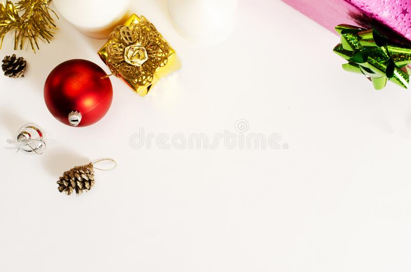 Red ball and gold giftbox christmas decoration on white backgrounds above, Top views. Close up of Red ball and gold giftbox christmas decoration on white royalty free stock images