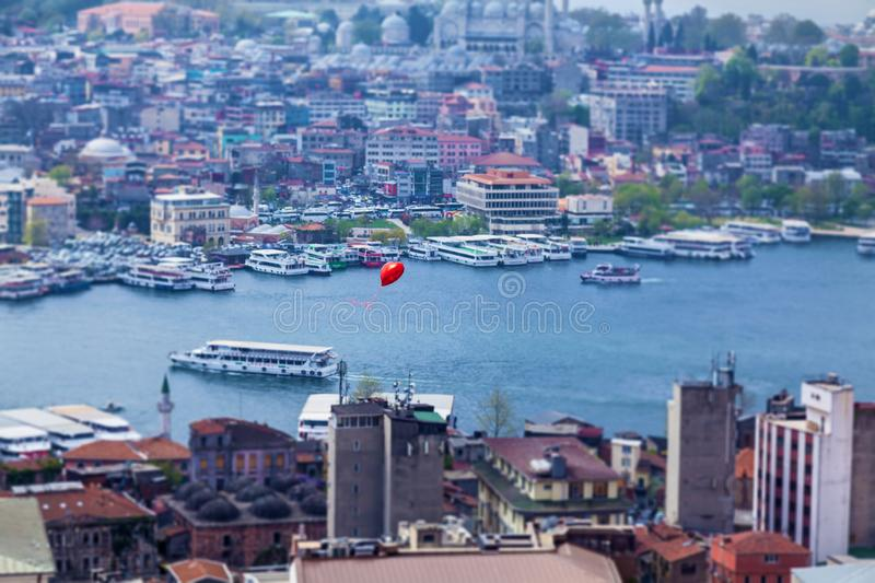 Sights of the city of Istanbul. Red balloon flying over Istanbul. Sights of the city of Istanbul architecture and boat trips on ships royalty free stock photos