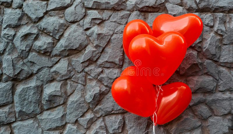 Red balloon heart on a background of gray stone. royalty free stock photo