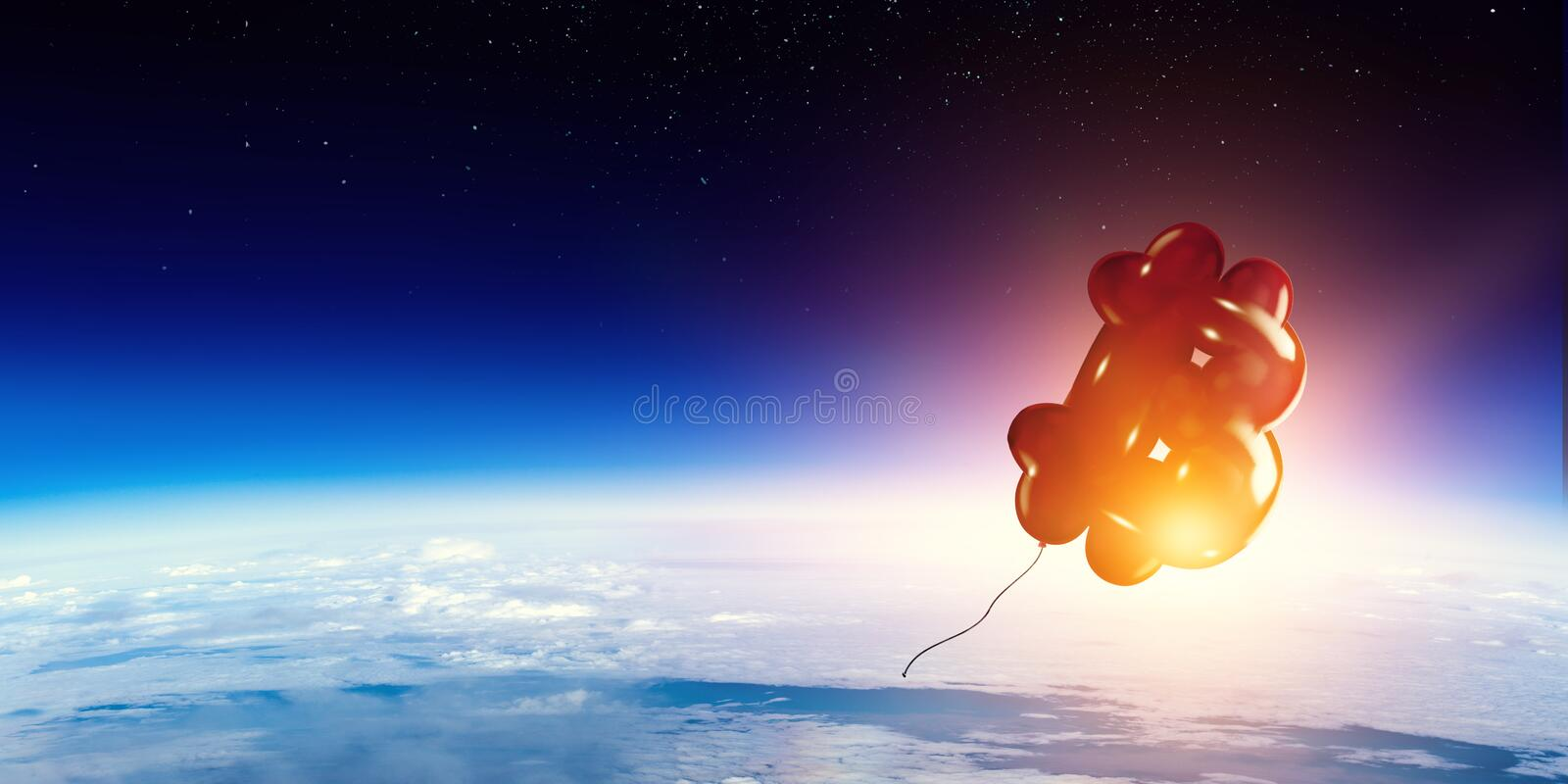 Red balloon in the shape of bitcoin currency symbol royalty free stock images