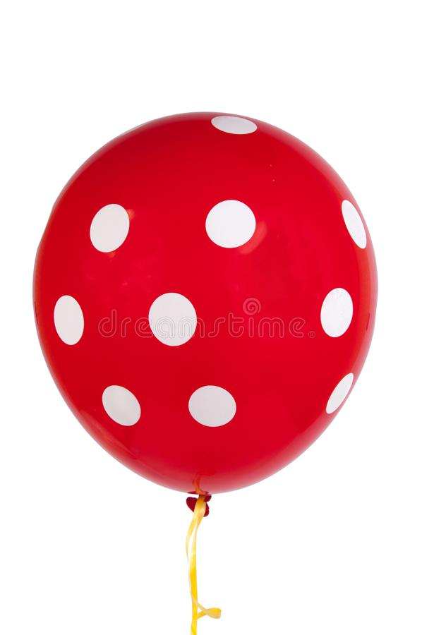 Balloons with white dots isolated. Red balloon with white dots isolated on the white stock photo