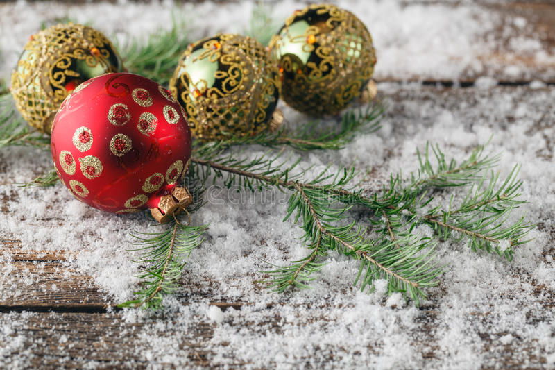 Red balls and pine cones covered with snow with space for the te stock photos