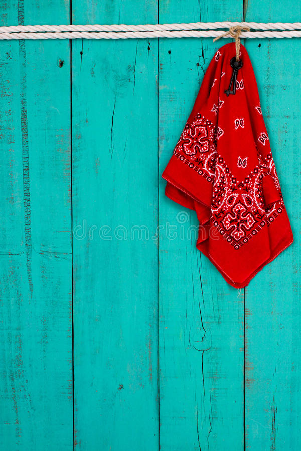 Red Bandana And Key Hanging By Rope On Antique Teal Blue